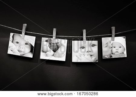Collage of black and white photos story of a baby and a mother hanging on the clothesline on a textured wall background. Family Childbirth New Life concept background.