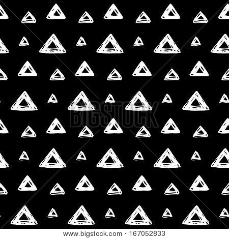 Abstract doodle pattern with hand drawn triangles. Cute vector black and white doodle pattern. Seamless monochrome doodle pattern for fabric, wallpapers, wrapping paper, cards and web backgrounds.