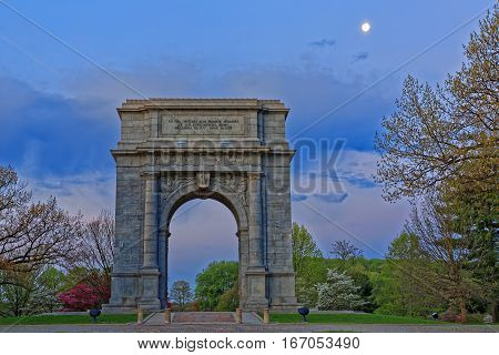Springtime dawn with the moon shining at Valley Forge National Historical Park in Pennsylvania USA.The National Memorial Arch is a monument dedicated to George Washington and the United States Continental Army.
