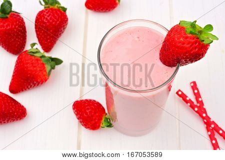 Healthy Strawberry Smoothie In A Glass, Downward View Against A White Wood Background