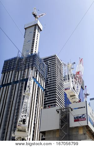 MELBOURNE, AUSTRALIA - January 12, 2017: Residential towers under construction in a city urban environment Melbourne Australia