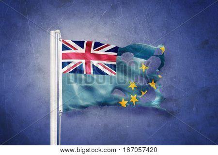 Torn flag of Tuvalu flying against grunge background