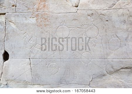Native rock carvings at Writing-On-Stone Provincial Park and Aisinaipi National Historic Site in Alberta Canada. The area contains a large concentration of First Nation petroglyphs and pictographs.