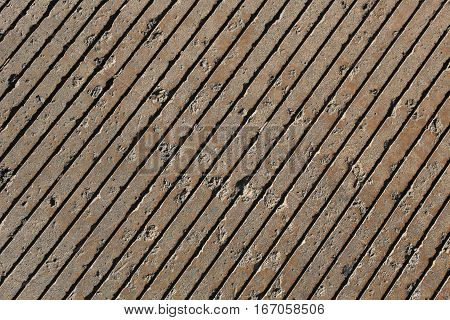Pavement with diagonal grooves pattern, pits, full frame