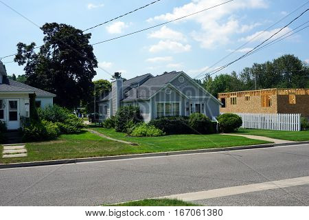 HARBOR SPRINGS, MICHIGAN / UNITED STATES - AUGUST 4, 2016: A small gray home on Fourth Street in Harbor Springs.