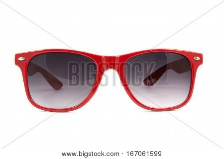 Beautiful red sunglasses on white background .