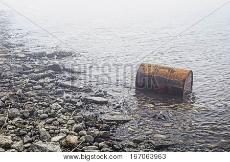Oil barrel in water pollution nature