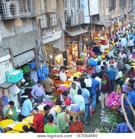 MUMBAI INDIA - JANUARY 11 2017: Mumbai Flower Market. Crowds fill the street at the Flower Market that opens at 4am and is over by 9am.