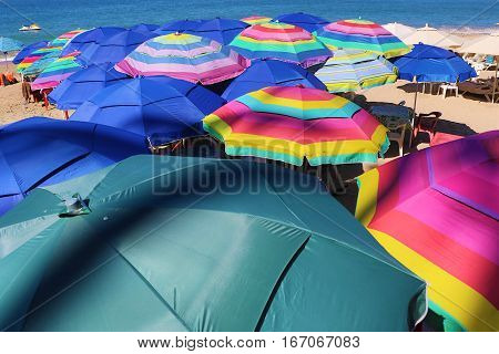 Set of umbrellas protect the bathers from the sun.