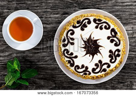 Delicious Sponge Prunes Cake With Cup Of Tea And Mint