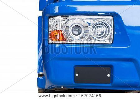 Focus on the big blue truck headlamp