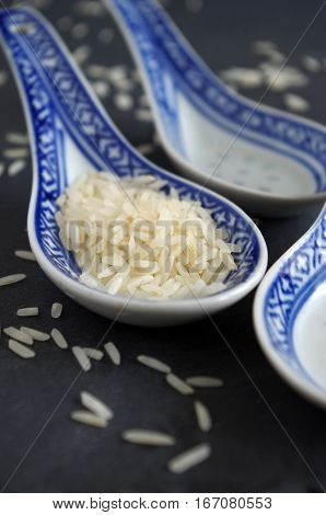 crude grains of rice of a chinese soup spoon