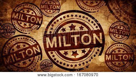 Milton, vintage stamp on paper background