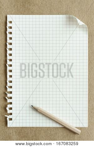 blank notepaper page on brown background Top view