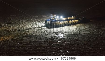 Icebreaker Ship Trapped in Ice at Night Aerial View