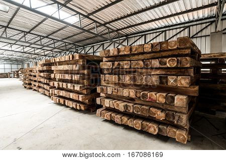 The group of wooden pallet in the factory. Pallet is a busy noun, but it's mainly a slab or framework of wood used for carrying things. The most common type of pallet is the kind used to move cargo.