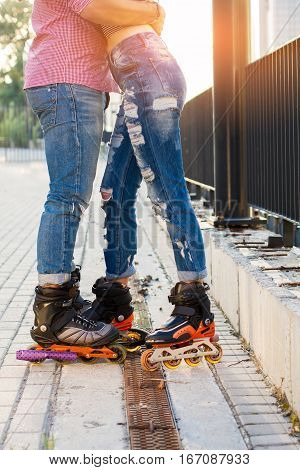 Legs of couple on rollerblades. Man and woman in jeans. Be bold and stylish.