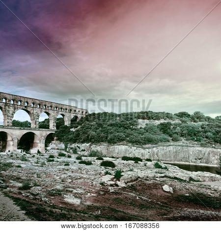 Ancient Roman Aqueduct Pont du Gard at Sunset Vintage Style Toned Picture