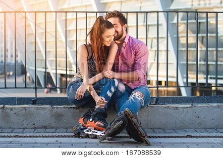Romantic couple of rollerbladers. Happy woman and man smiling. Falling in love with you.