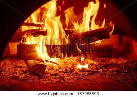 Fire burning in the chimney, cozy sweet home concept