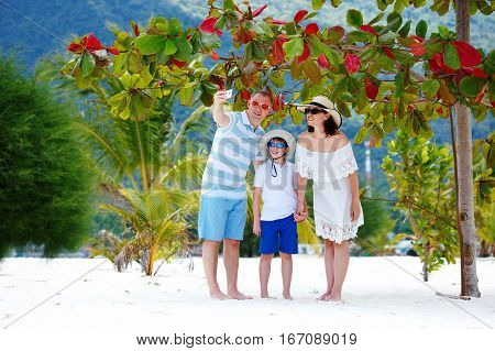 Beautiful family at beach making a self portrait with mobile phone, Koh Phangan island, Thailand, Asia