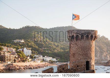 Tower with the flag of Catalonia. Costa Brava. Tossa de Mar Catalonia Spain.