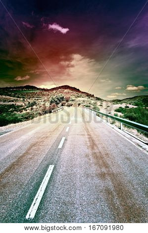 Winding Asphalt Road at Sunset in Spain Vintage Style Toned Picture
