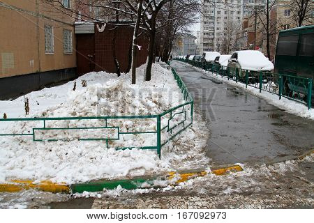 Vidnoe Moscow region Russia - December 27 2016: A pile of dirty snow in the yard of a house in Vidnoe