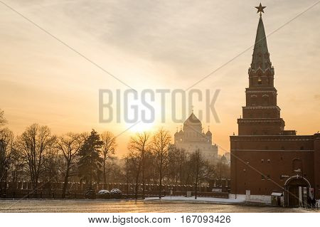 Borovitsky tower and gate of Moscow Kremlin and Christ the Savior cathedral at sunset