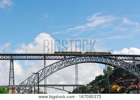 Metro Train on the Bridge Built by Eiffel in Porto