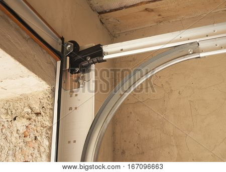 Garage door openers system. Close up on Detail of Garage Door Installation