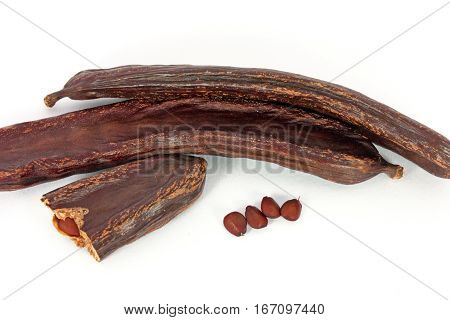 Bunch of dried carob isolated on white