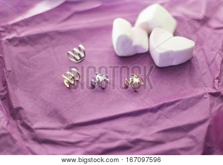 Beautiful earrings on a pink background. Earrings with marshmallows