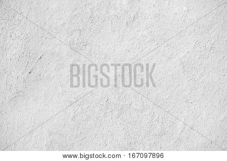 closeup of old white stucco clay wall rough surface background with abstract grain detail or backdrop in architectural material concept