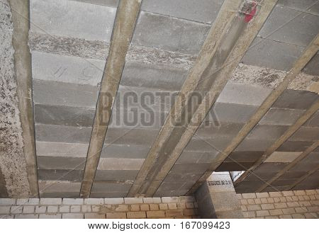 Types of ceilings rib-detached houses. Close up on monolithic-prefabricated ceilings consist of reinforced concrete beams truss blocks slabs of concrete overlay. Flooring with girder-slabs.