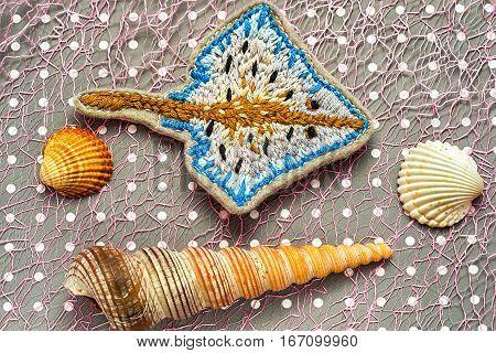 hand made embroidered ramp fish among seashells