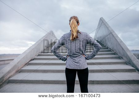 Young Woman Standing By Steps Outdoors