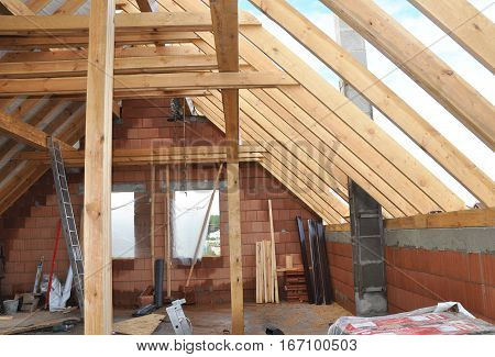 Building Attic Interior. Roofing Construction Indoor. Wooden Roof Frame House Construction Interior. AtticRroom under Construction. Attic Insulation.