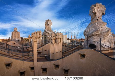 Barcelona, Spain - Jan 17, 2017: Casa Mila (La Pedrera) chimneys. Famous Catalan architect Gaudi. UNESCO heritage