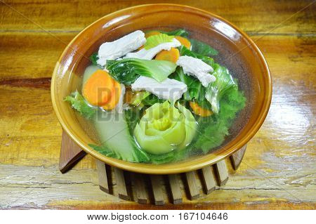 boiled mixed vegetable with pork in mild soup on bowl
