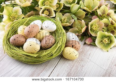 Easter decoration with spring flowers in yellow green colors