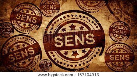 sens, vintage stamp on paper background