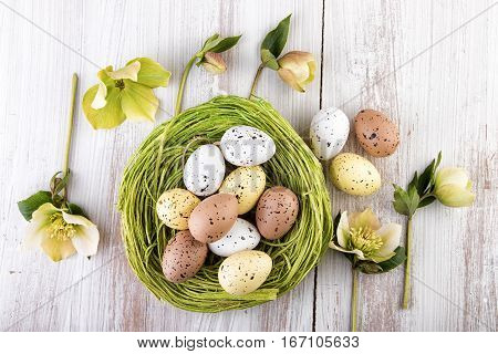 Easter Egg decoration over wood top view
