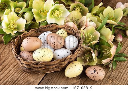 Easter eggs decoration pastel color on old wooden table