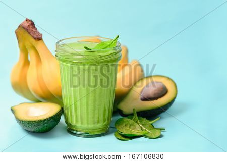 Healthy avocado and banana spinach smoothies in a glass