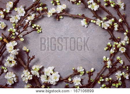Spring floral background blooming branches on a vintage surface top view blank space