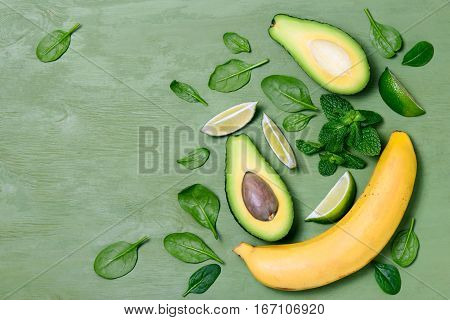 Avocado and banana spinach smoothies concept top view flat lay space for a text