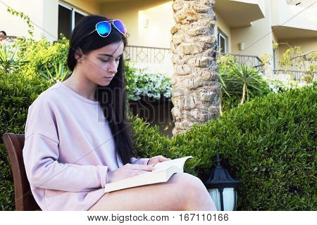 Beautiful Girl. A Girl Reads A Book.