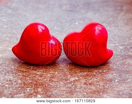 Hearts on the red color of the old background.