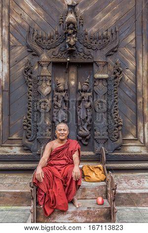Mandalay, Myanmar - November 30, 2016 : Buddhist monk posing in the Shwe In Bin Monastery in Mandalay city Myanmar